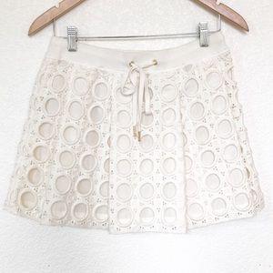 Juicy Couture ivory circle eyelet mini skirt Sz XS